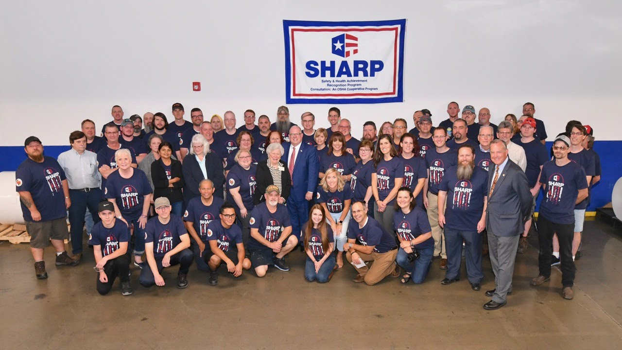 Team photo with Governor Hogan in front of SHARP banner