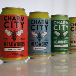 Four different cans from Charm City Mean Works