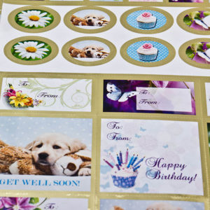 A sheet of assorted sized stickers with messages for special occasions